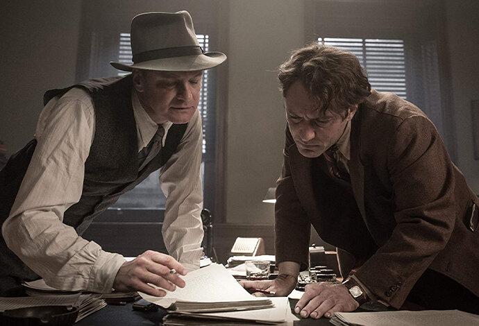 Colin Firth dan Jude Law dalam Genius